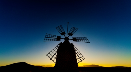 windmill at sunset photo
