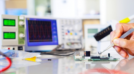 Replacement semiconductor sensor on the robot controller Stock Photo