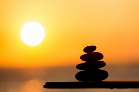 Sunset and zen stones photo