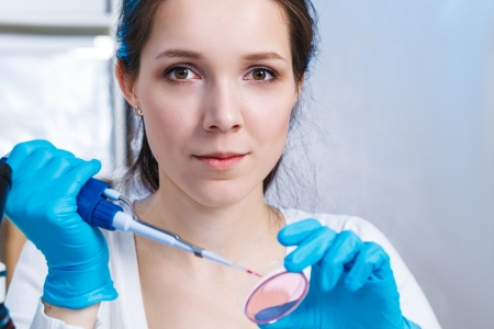 Woman  in the microbiology laboratory photo