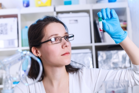 Woman  in the microbiology laboratory Stock Photo - 24767158