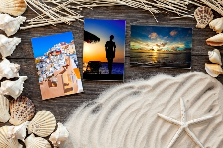 marine items on a wooden boards against sandy background, blank sea  cards photo