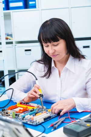 Woman in development of an electronic micro processor