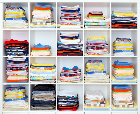 towels, bed sheets and clothes on the shelf Stock Photo