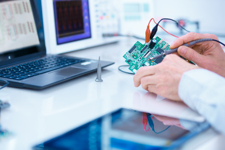 computer repairing: repair and adjustment of the electronic device Stock Photo