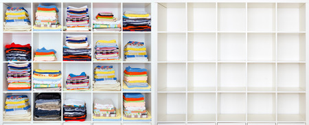 towels, bed sheets and clothes on the shelf, and ampty case photo
