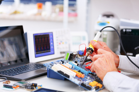 pc repair: repair and adjustment of the electronic device Stock Photo
