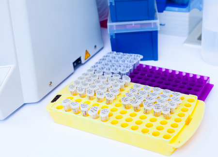 Laboratory research of cancer diseases,  rack with RNA samples photo
