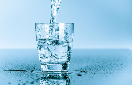 water splashing: water to drink poured into a glass Stock Photo