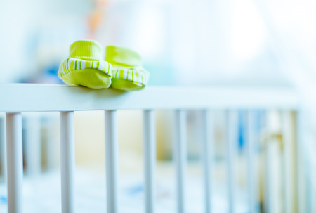 baby booties on a cot photo