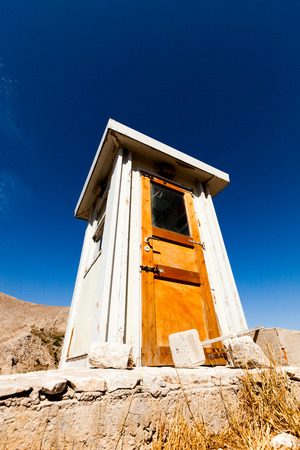 bluer: wooden toilet house in the mountain