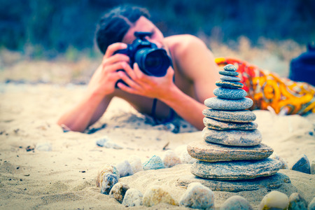 Stock photographer take pictures of stone pyramid photo