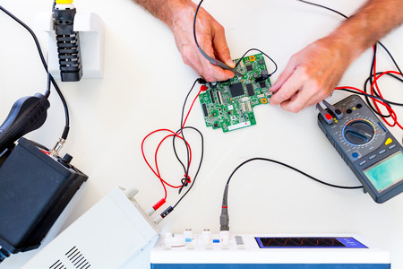 Development of electronic devices in the modern electronics laboratory, on a table,  microprocessor oscilloscope and  multimeter Stock Photo