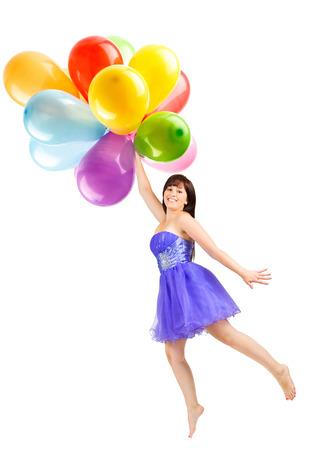 donna volante: giovane donna volare con palloncini