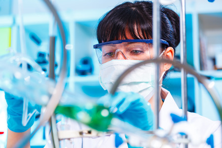 chemic: Female lab doing an experiment on the synthesis of the artificial protein