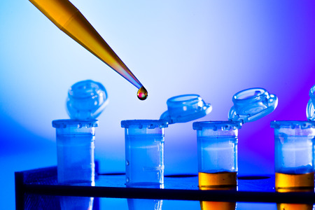 reprogenetics research in the laboratory, test tubes and pipette Stock Photo