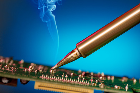 solder: Solder and electronic circuit board