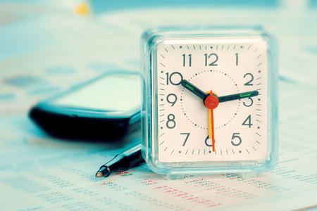 ballpen: Alarm clock, cellphone, paper and ballpen