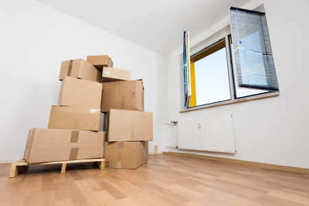 cardboard boxes in an empty apartment. moving to a new apartment photo
