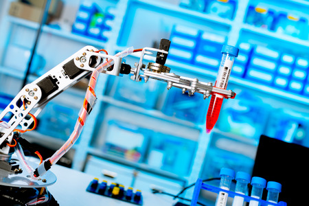 pharmaceutical: robot manipulates chemical tubes in the laboratory Stock Photo