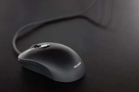 BERLIN, GERMANY - OCT. 25, 2014 Close up of an Microsoft Mouse. Microsoft Corporation  is an American multinational corporation