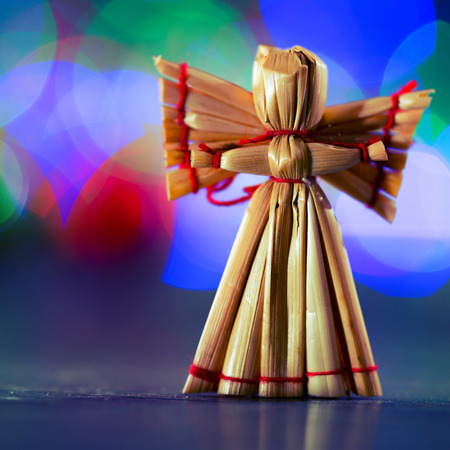 Christmas angel on a background of colored bokeh photo