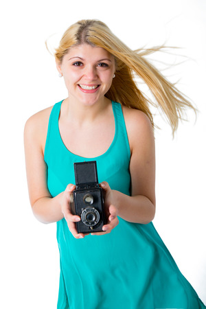 blonde girl in a summer dress with retro photo camera photo