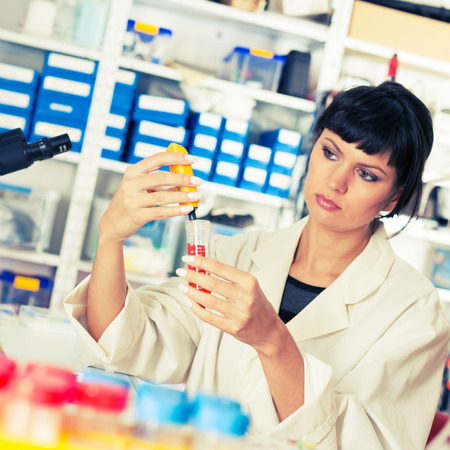 food testing: Young student woman medical  scientific research  doctor make food quality testing Stock Photo