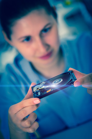 girl student with a hard disk HDD in the hands photo