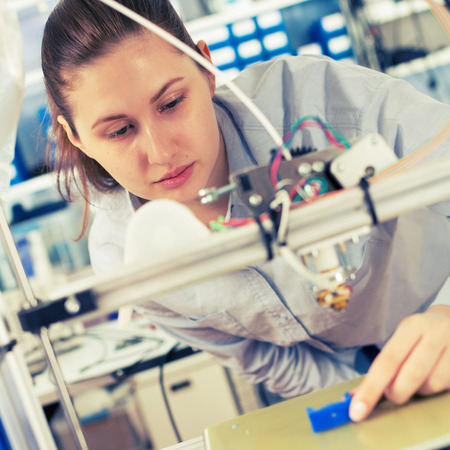 girl student makes the item on the 3D printer Stock Photo