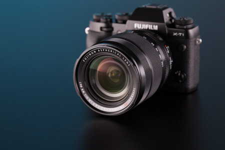 ccd camera: BERLIN, GERMANY - OCT. 25, 2014:Fujifilm X-T1 Mirrorless Digital Camera on black background. GoPro is a brand of action cameras Editorial