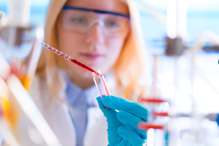 amplification: Girl with a pipette in a lab University Hospital