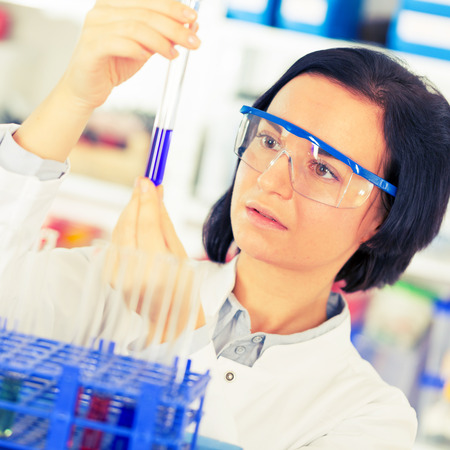 drug discovery: Woman with test tube