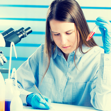 Technician with test tube  in a medical lab photo