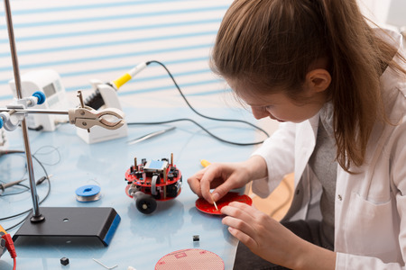 electrical component: Girl Solder and adjust Electronic Device