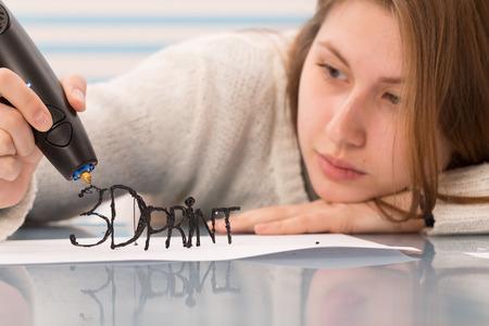 pen: Girl uses a 3D pen to model an item Stock Photo