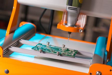 cnc machine: PCB Processing on CNC machine Stock Photo