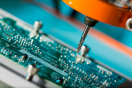PCB Processing on CNC machine Stock Photo