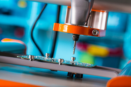 components: PCB Processing on CNC machine Stock Photo