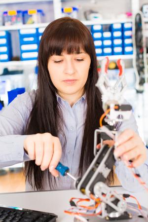 robot arm: cientist adjusts the robot arm