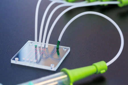 integrates: A lab on chip is device integrates several laboratory processes in one device, mostly LOC based on glass plate.