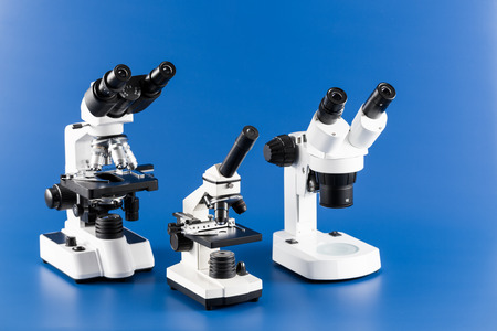 monocular: Monocular, binocular and trinocular microscopes on blue background