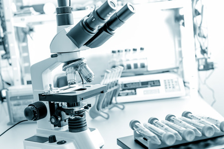 lab test: microscope in medical laboratory Stock Photo