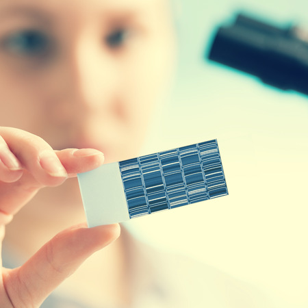 dna laboratory: chromatogram sequencing on slide in woman hand