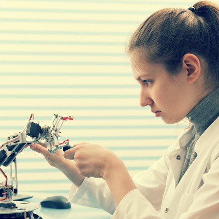 engineers: Girl Solder and adjust Electronic Device