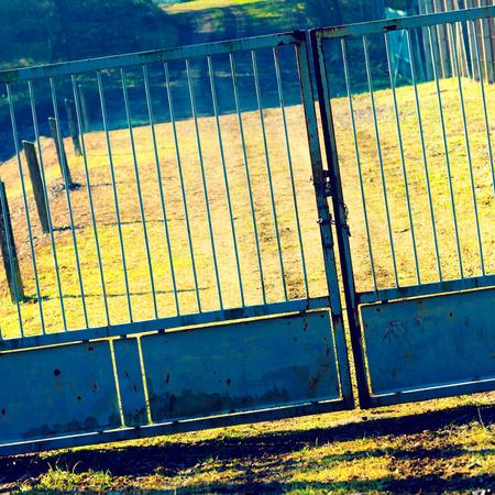 metal gate: rusty metal gate outdoor Stock Photo