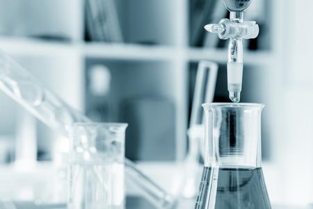 bio medicine: pipette and chemical glass in laboratory blue color Stock Photo