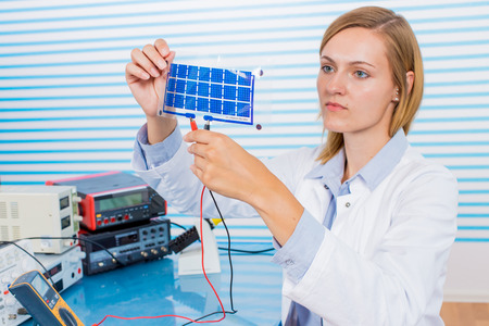 The technician is testing film solar cells