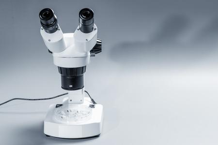 monocular: monocular microscope on blue background