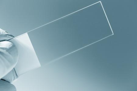 microscope slide in hand